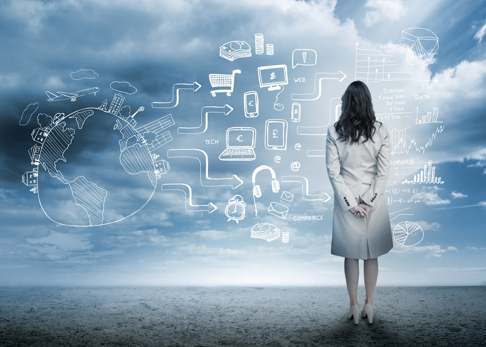 Businesswoman looking out at brainstorm drawings in cloudy landscape.jpeg
