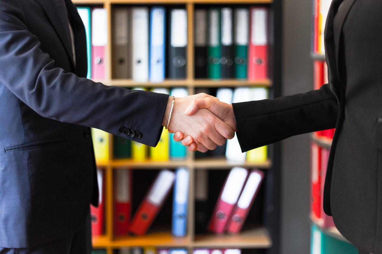 blurred-hands-handshake-2058130